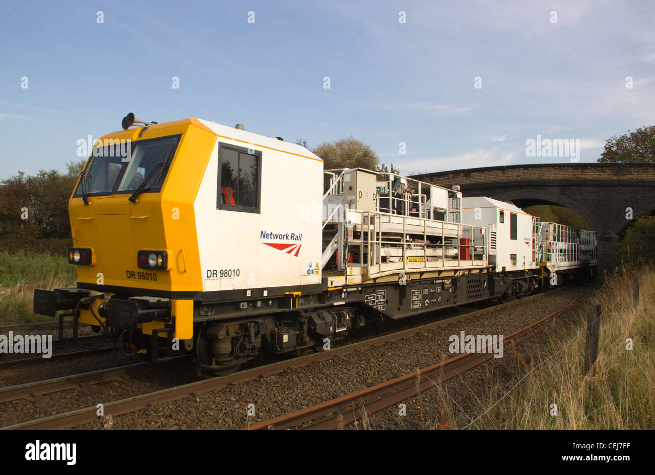 Network Rail track machine DR 98008 awaits its path onto the Derby to Birmingham line at Stenson, Derby. - Stock Image