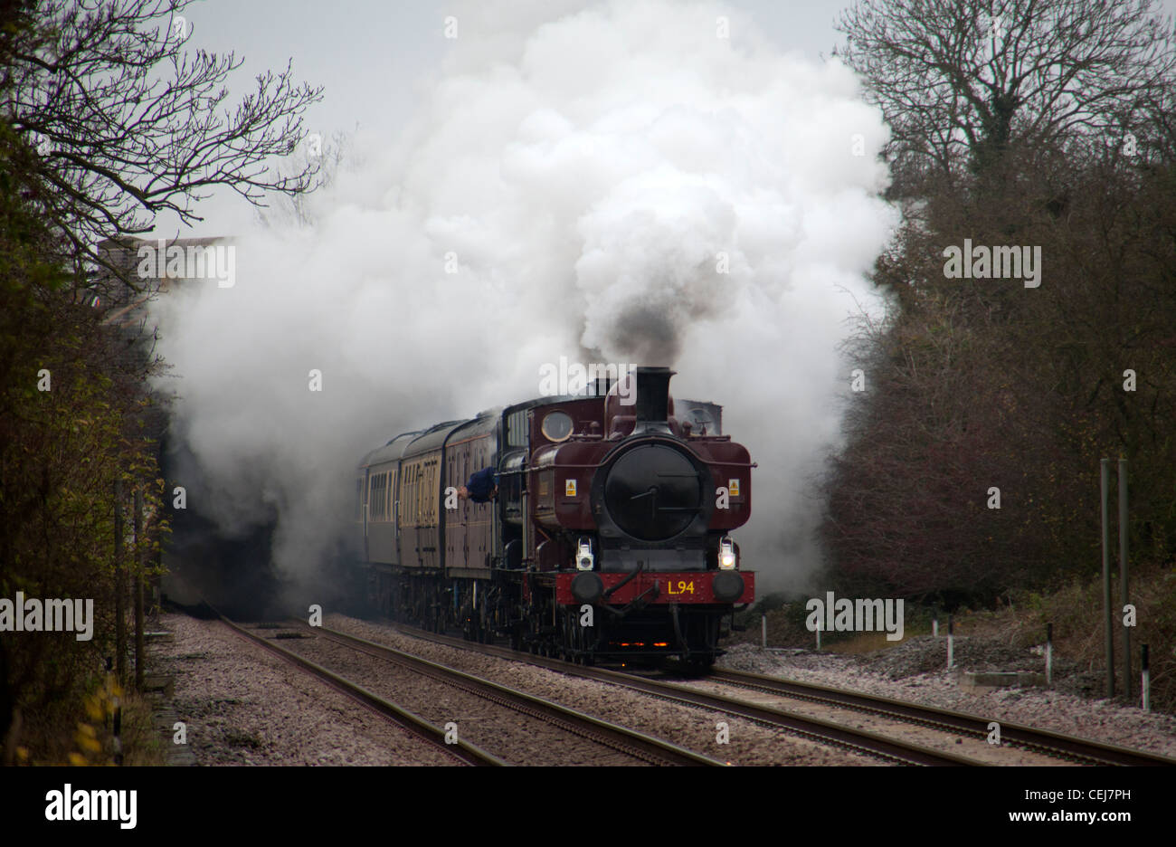 Pannier tank steam locomotives 7752 and 9600 pass Narborough, Leicestershire, England with charter train - Stock Image