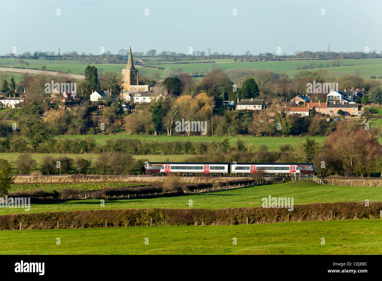 Arriva Cross Country class 170 passes the church and village of Hoby, Leicestershire - Stock Image