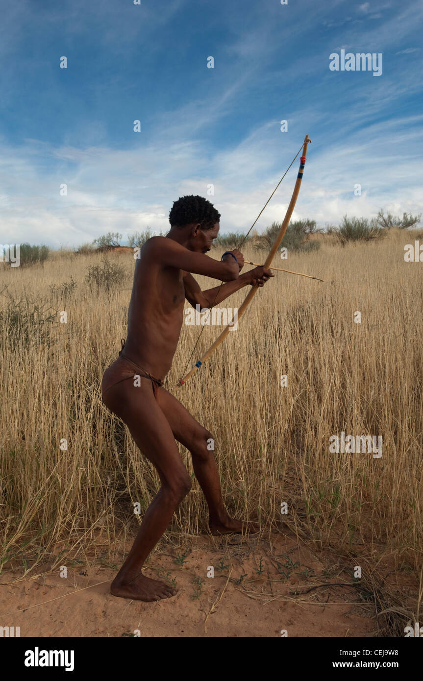 Bushmen hunting with a bow and arrow at the Bushman cultural village,Xaus Lodge,Kgalagadi Transfrontier Park,Northern - Stock Image