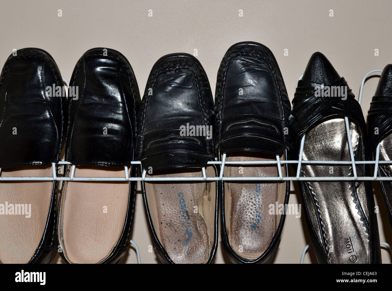 shoe rack with womens work shoes - Stock Image
