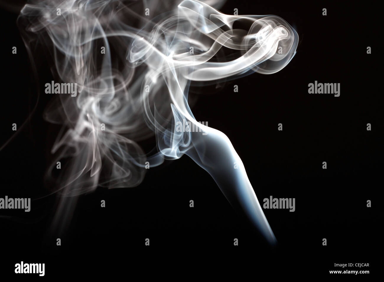 Abstract smoke curling and creating beautiful shapes - Stock Image