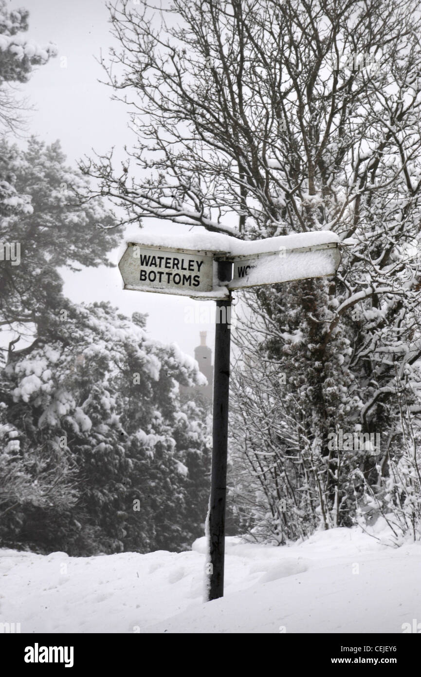 An amusingly altered road sign with a covering of snow near the village of Waterley Bottom near Wotton-under-Edge, - Stock Image