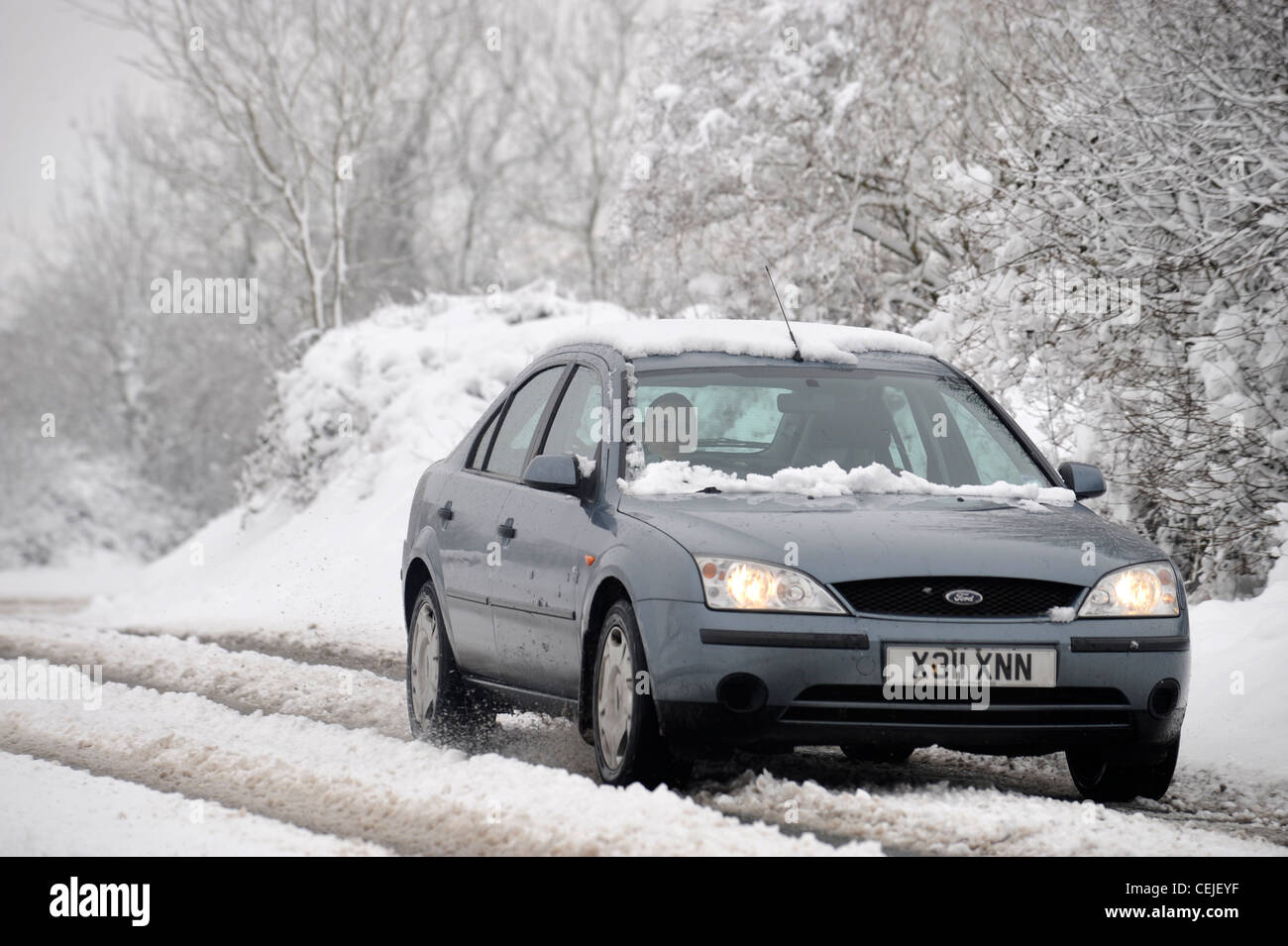 A Ford Mondeo saloon car in thawing snow UK - Stock Image