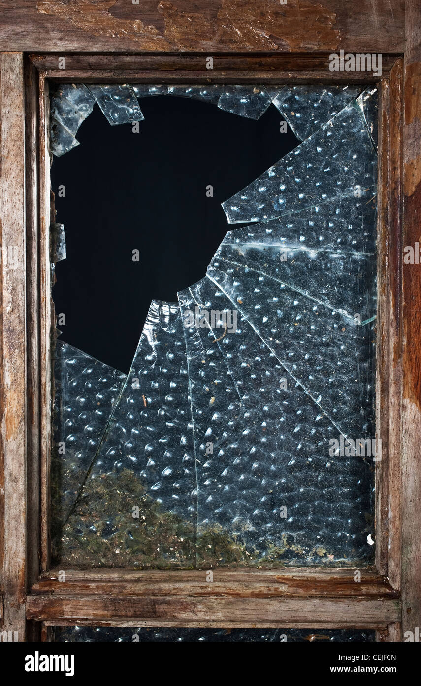 A broken glass window pane - Stock Image