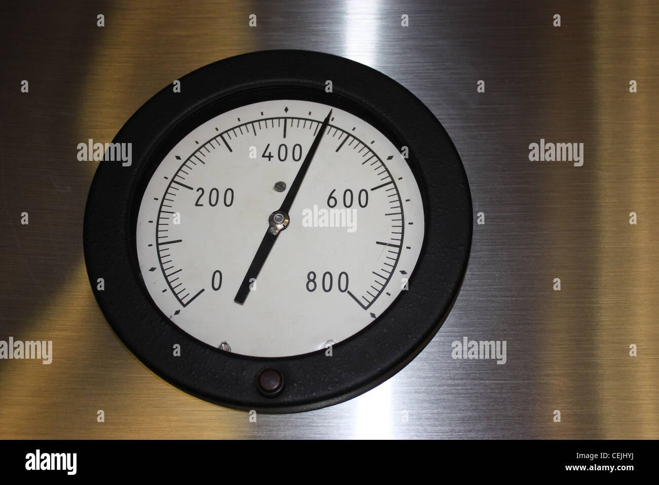 Pressure gauge instrument to monitor pressure. - Stock Image