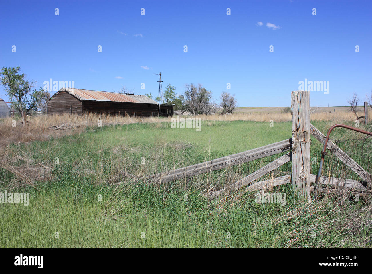 A ranch with an old barn no longer used - Stock Image