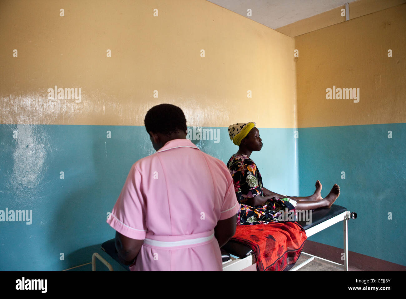 A woman receives a health exam at a clinic in Amuria, Uganda, East Africa. - Stock Image