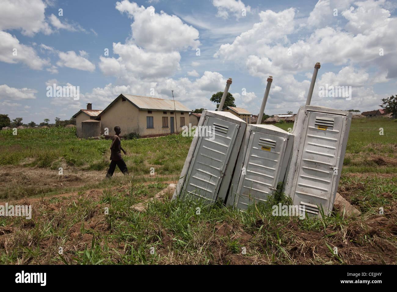 Dysfunctional toilets sit derelict in Amuria, Uganda, East Africa. - Stock Image