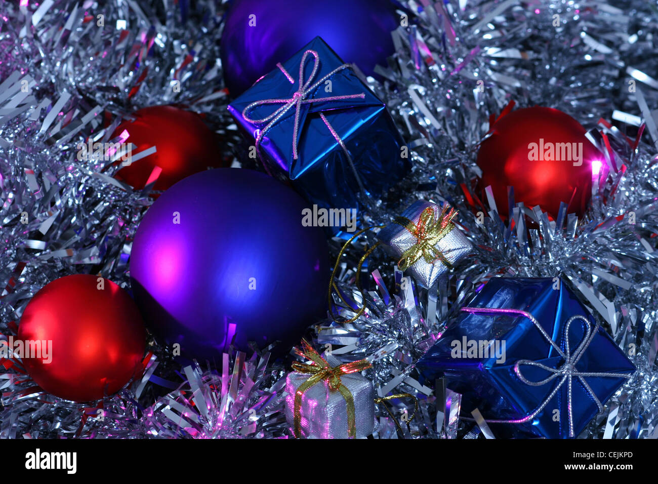 a metallic red bauble christmas tree decorations large blue metallic baubles metallic blue wrapped presents and small
