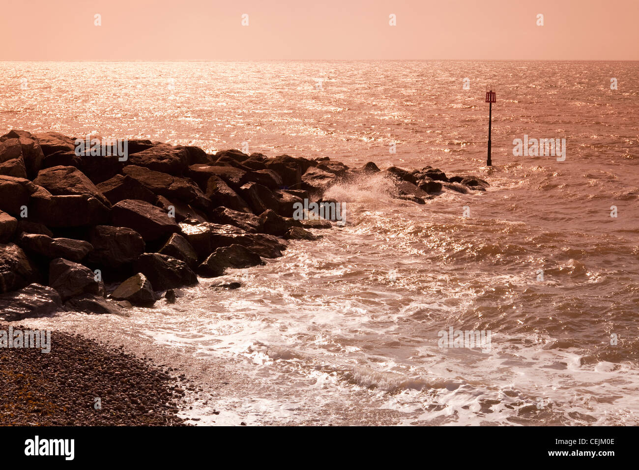 England Devon Sidmouth Seafront with rocks and crashing waves - Stock Image
