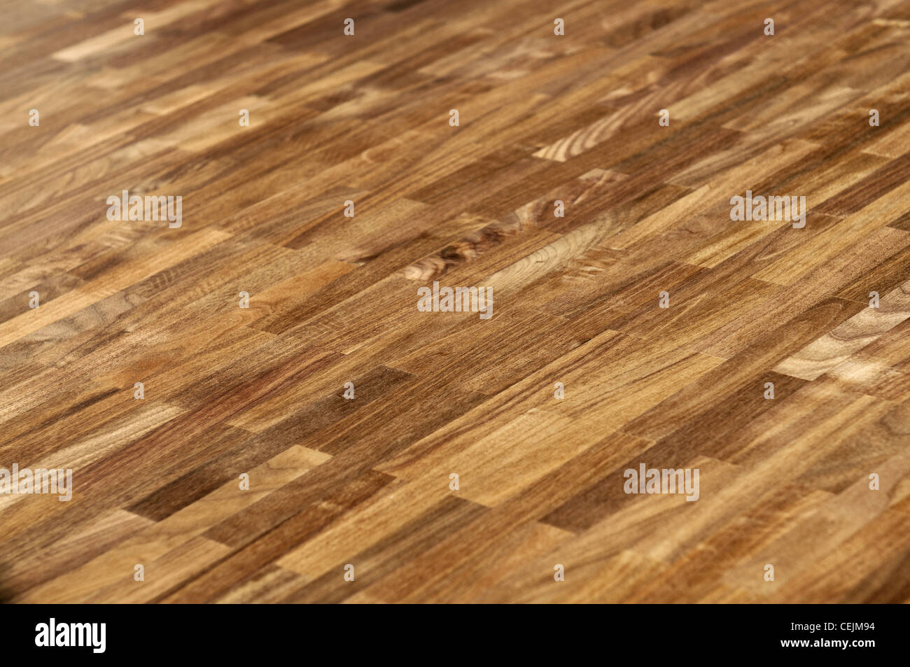 Wood texture - parquet floor made of the natural american walnut wood. - Stock Image