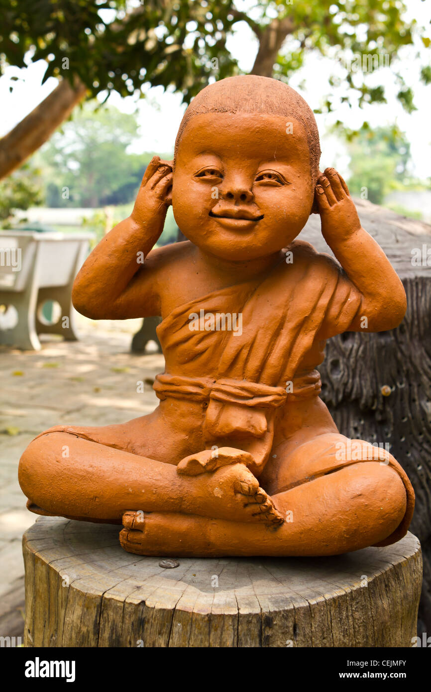 statue of a cute little monk in temple Thailand Stock Photo