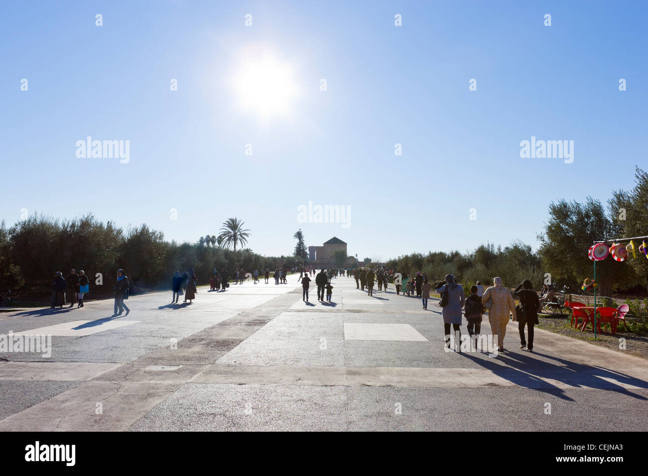 Local people taking an early evening stroll in the Menara Gardens, Marrakech, Morocco, North Africa - Stock Image