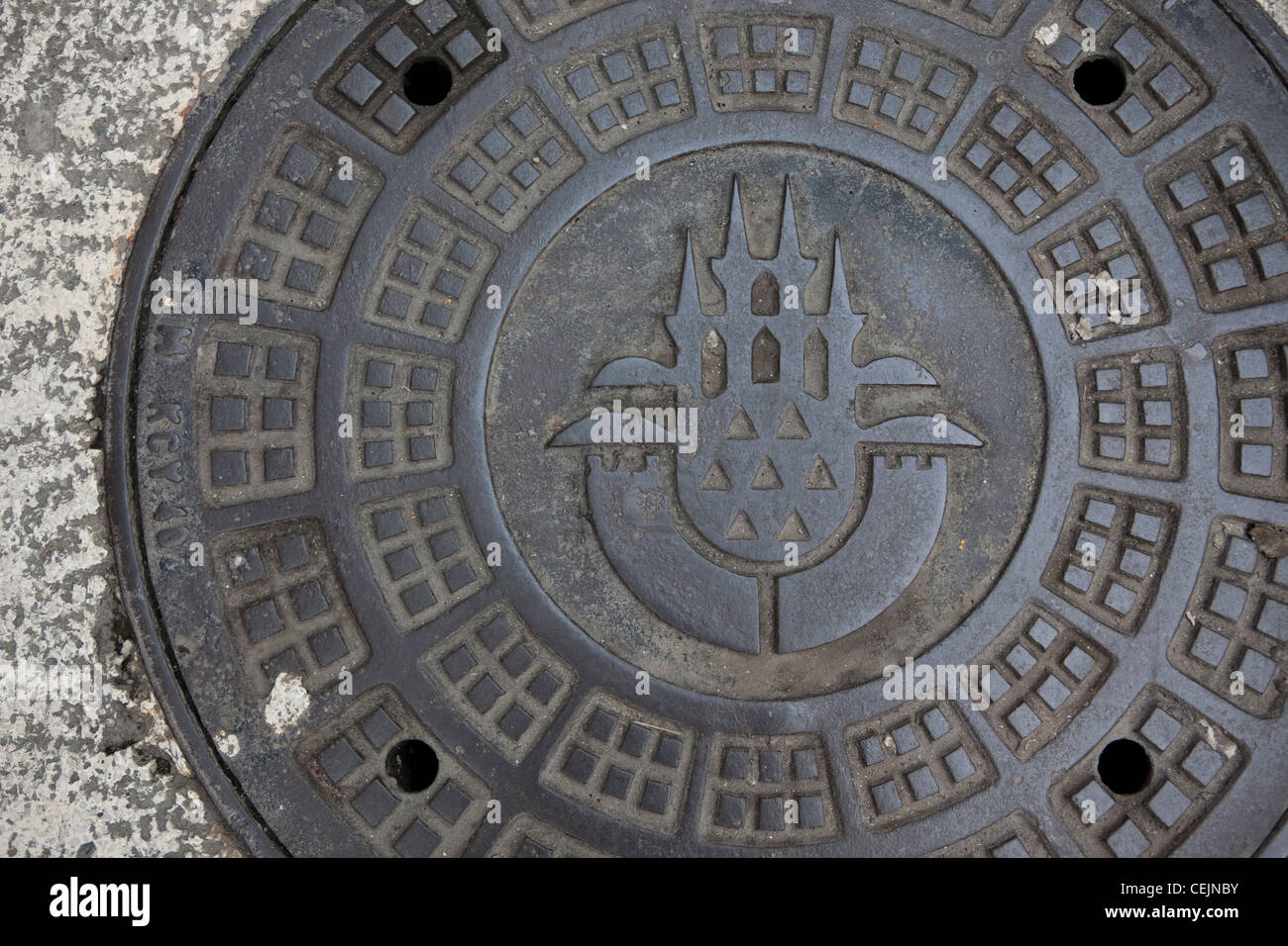 Manhole cover with city seal, Istanbul. - Stock Image