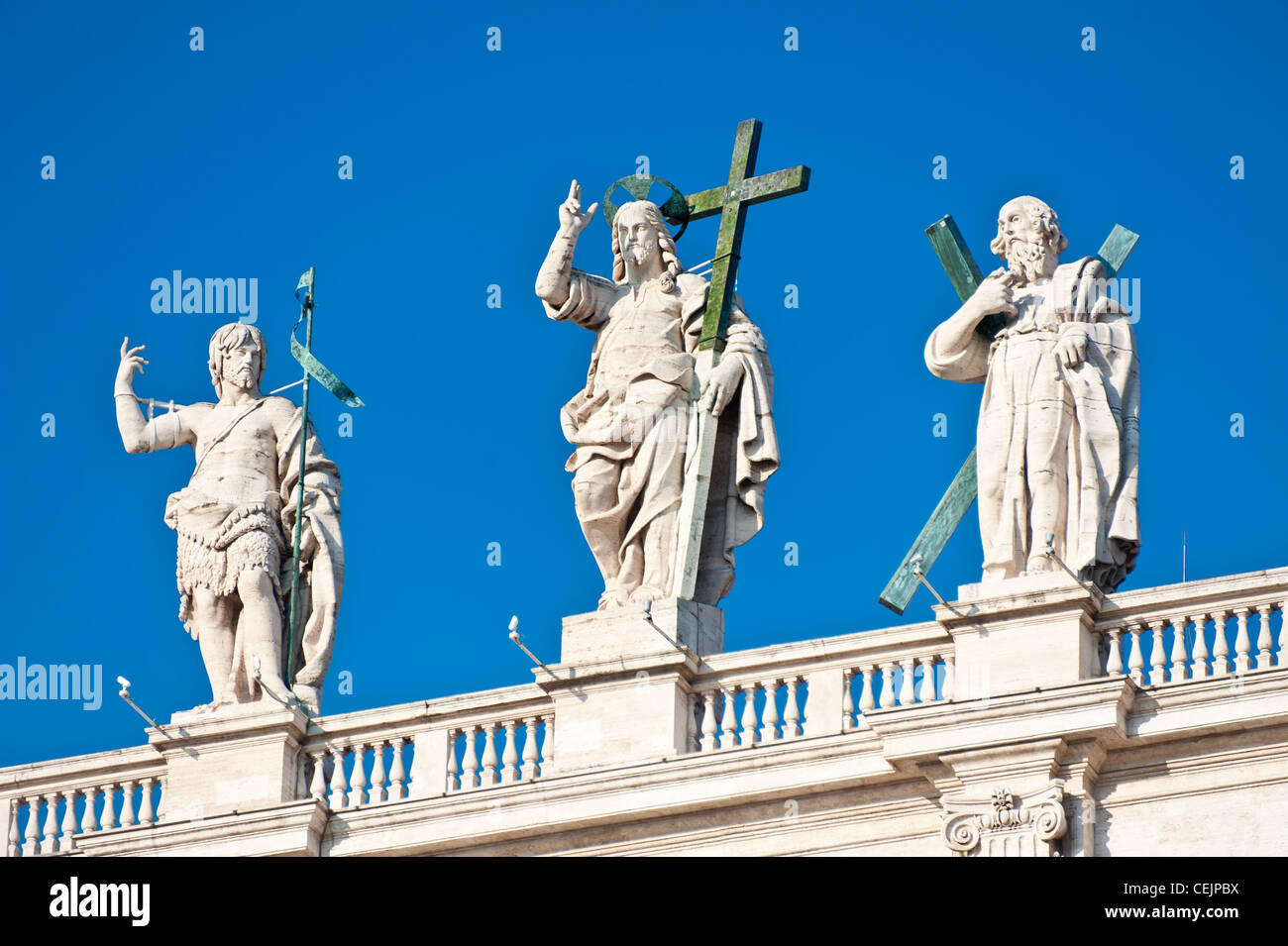 The statues of the saints on top of the roof of St. Peter's Basilica, Vatican, Italy. - Stock Image