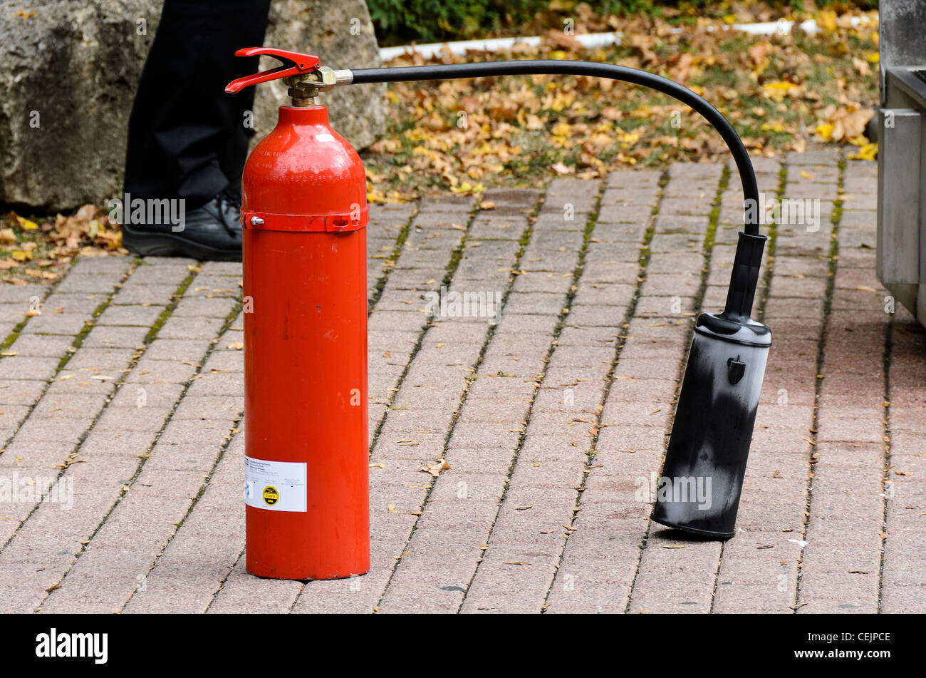 Fire extinguisher used for fire fighting training - Stock Image