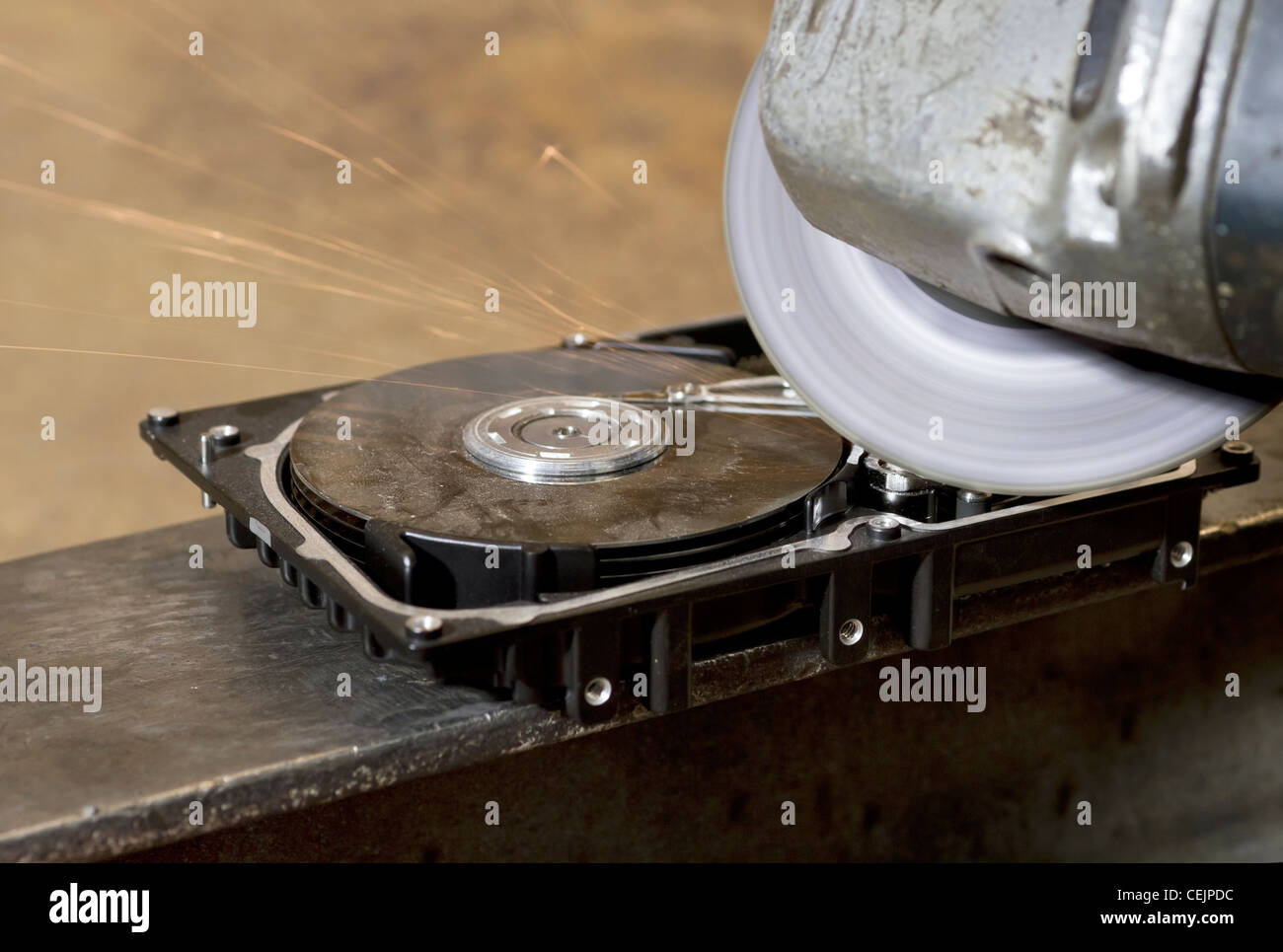 angle grinder while grinding a hard disk drive - Stock Image