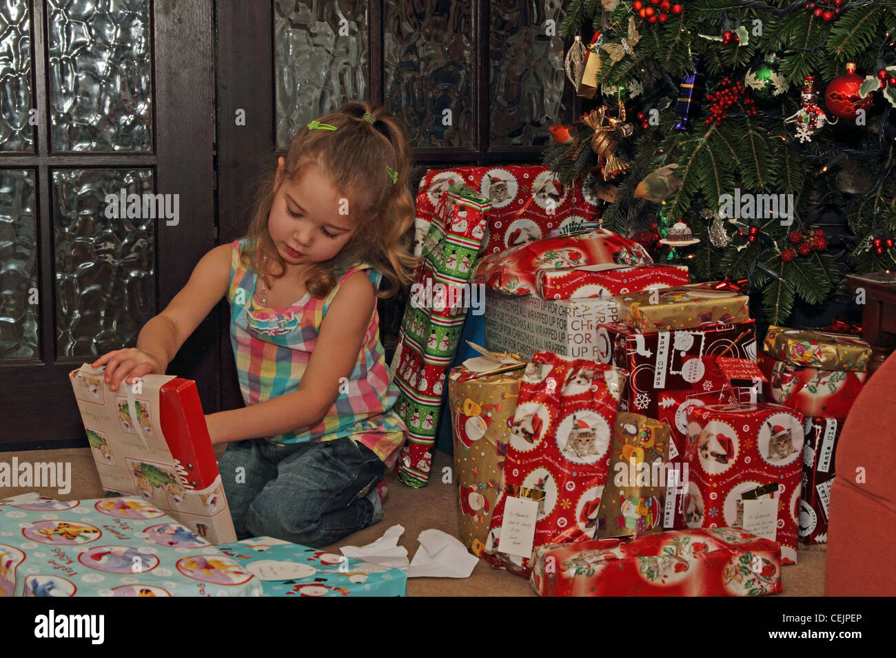 3 year old girl opening christmas presents - 3 Year Old Christmas Gifts