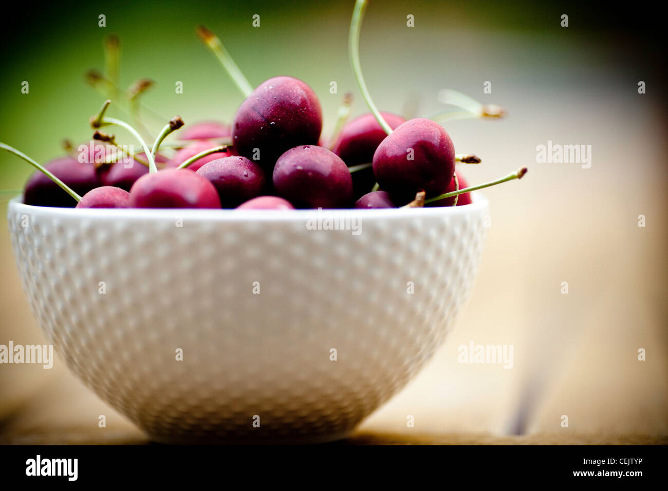 Cherries in a bowl - Stock Image