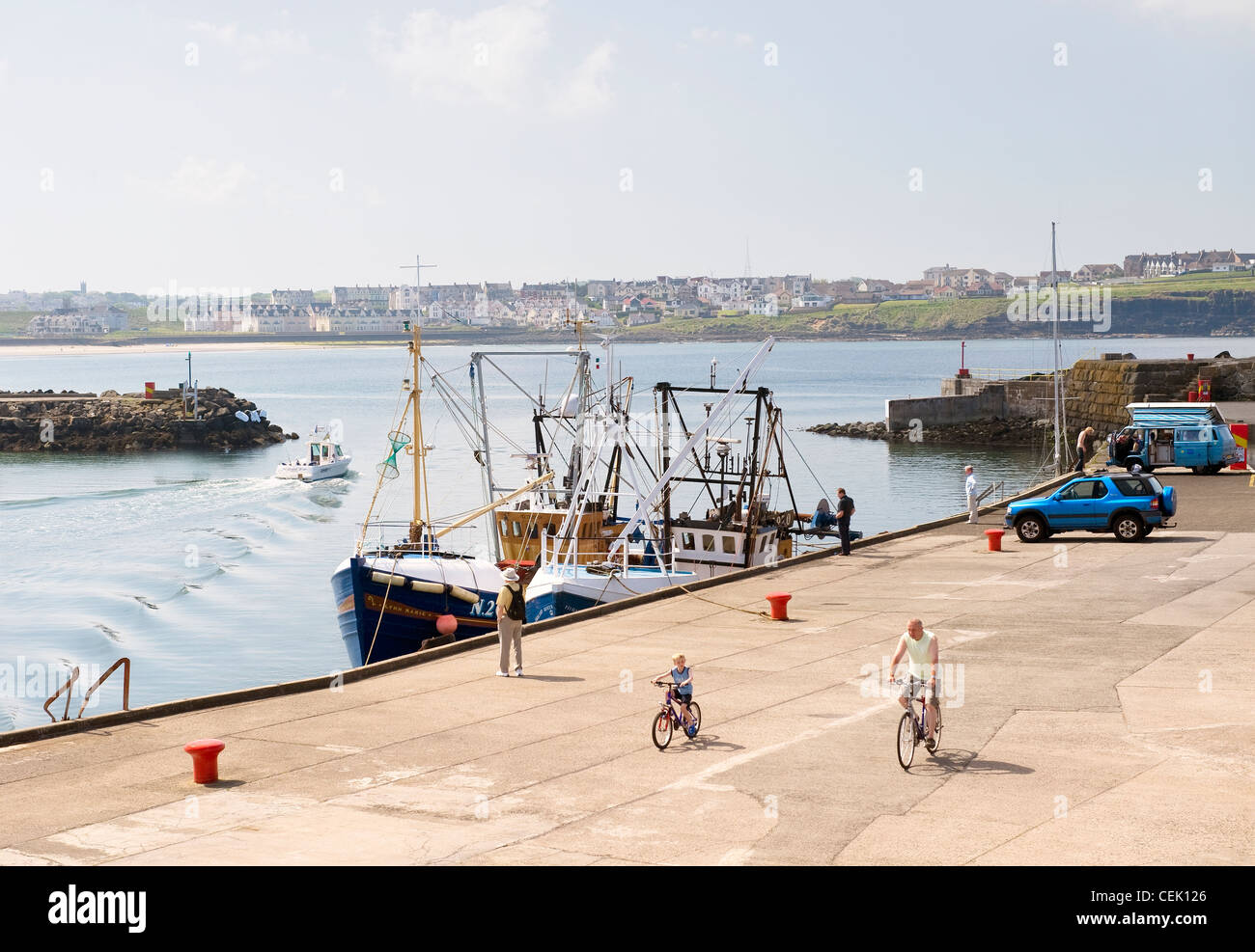 Fishing boats in the harbour at Portrush, County Antrim, Northern Ireland - Stock Image