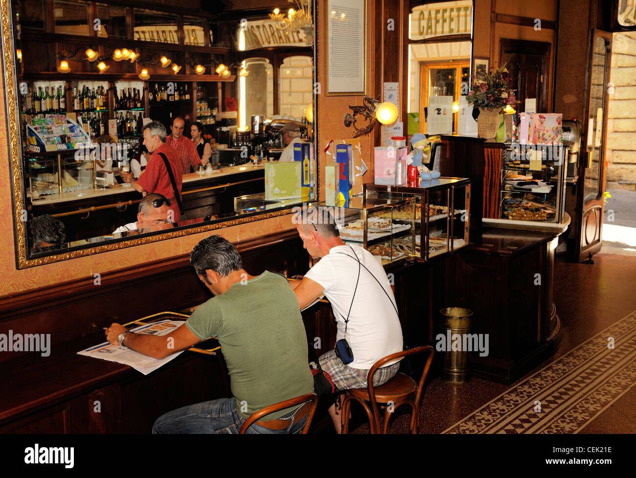 Men Read Newspapers In Bar Of Classic Late 19th C Italian Style Caf Poliziano The Town Centre