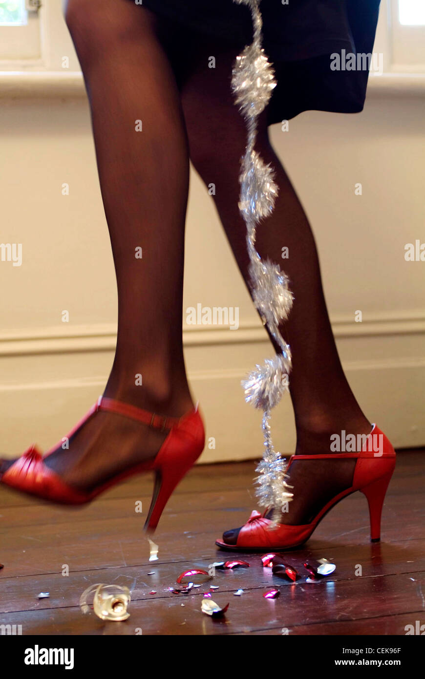 78b817f2c92 Cropped lower legs of female wearing black tights and red high ...