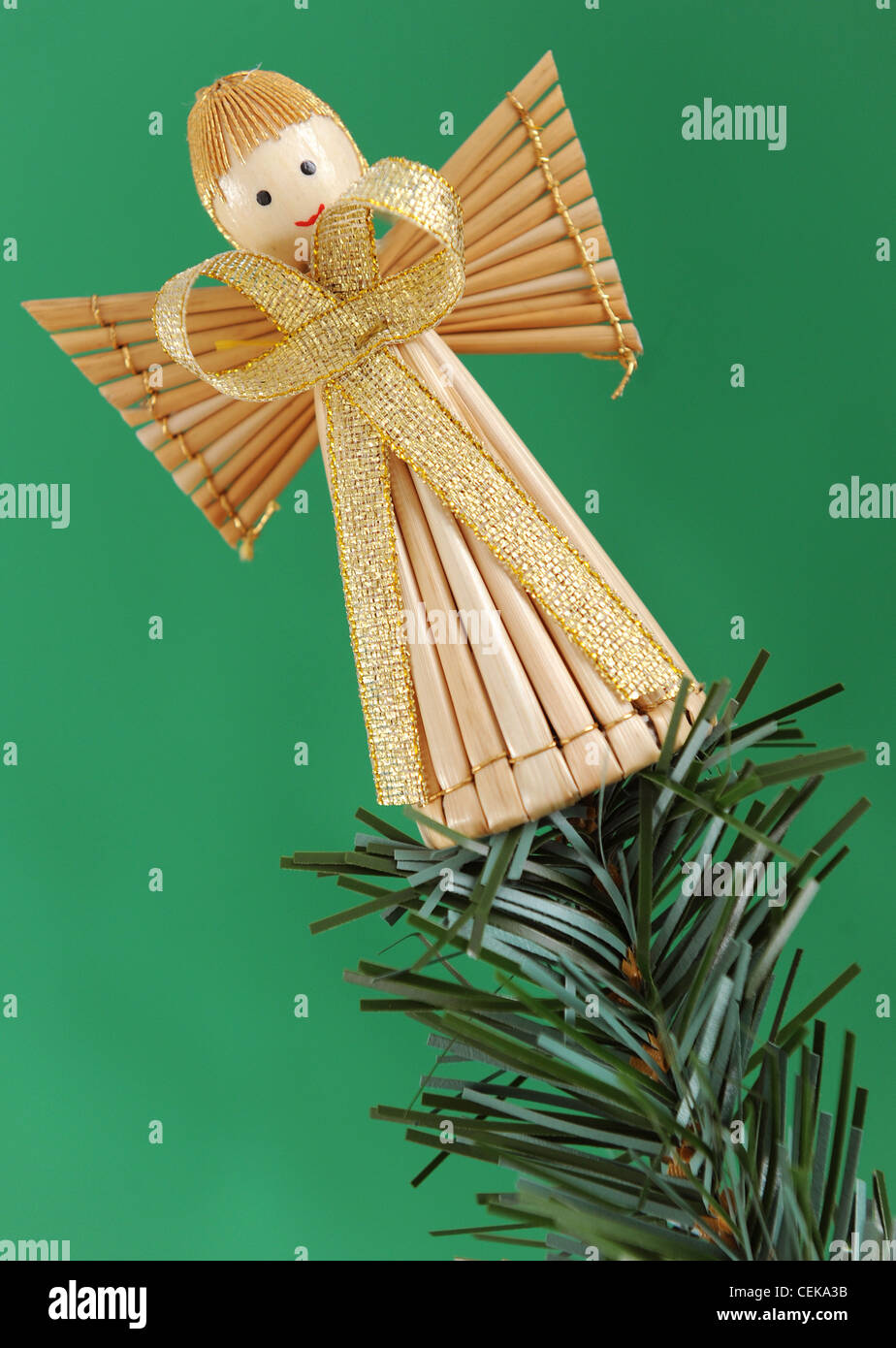 Angel Shaped Christmas Tree.A Straw Angel Shaped Tree Decorations At The Top Of A