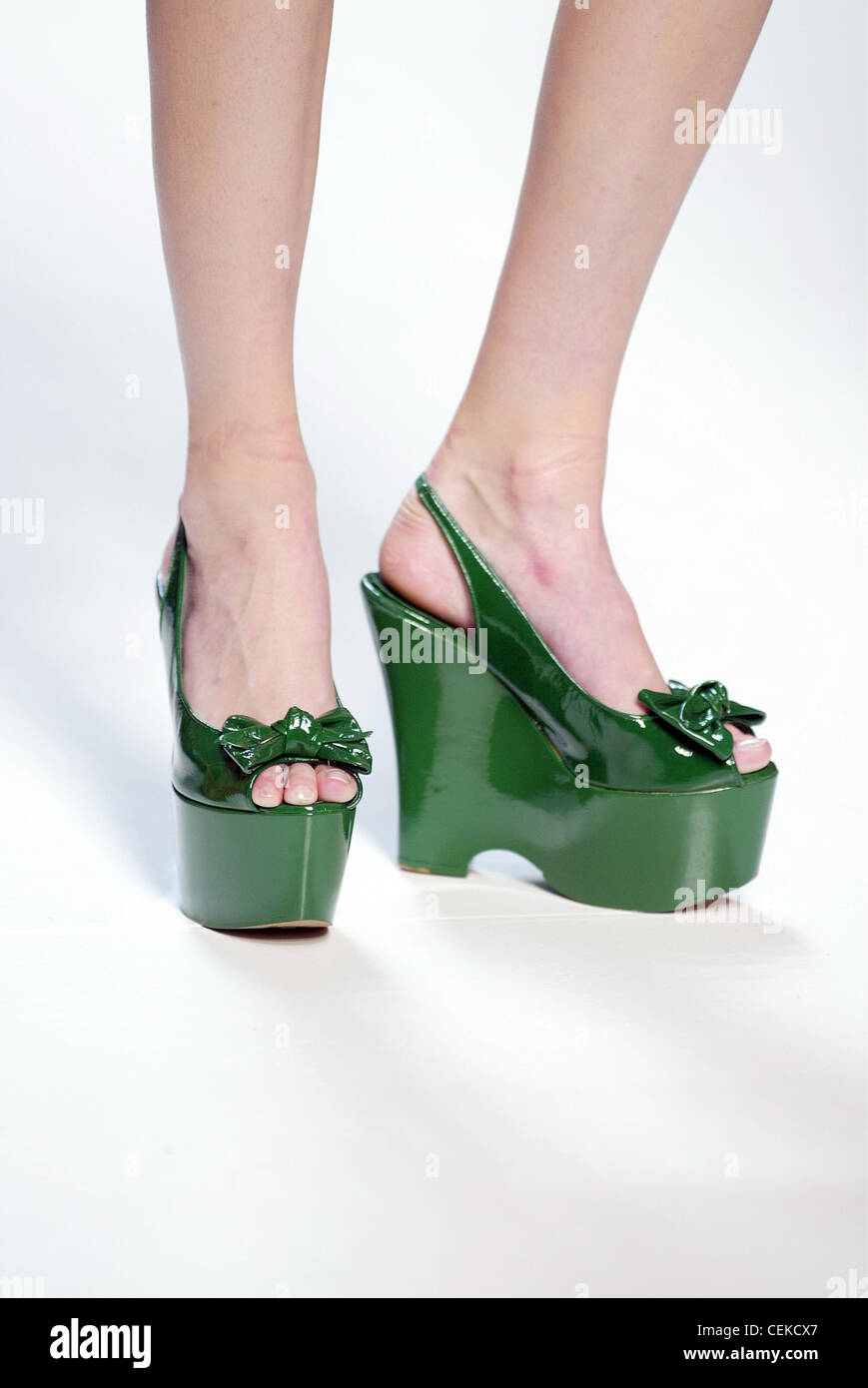 9668da8880d Moschino Cheap and Chic Milan Ready to Wear S S Cropped legs of model  wearing green patent leather platform slingbacks ribbon