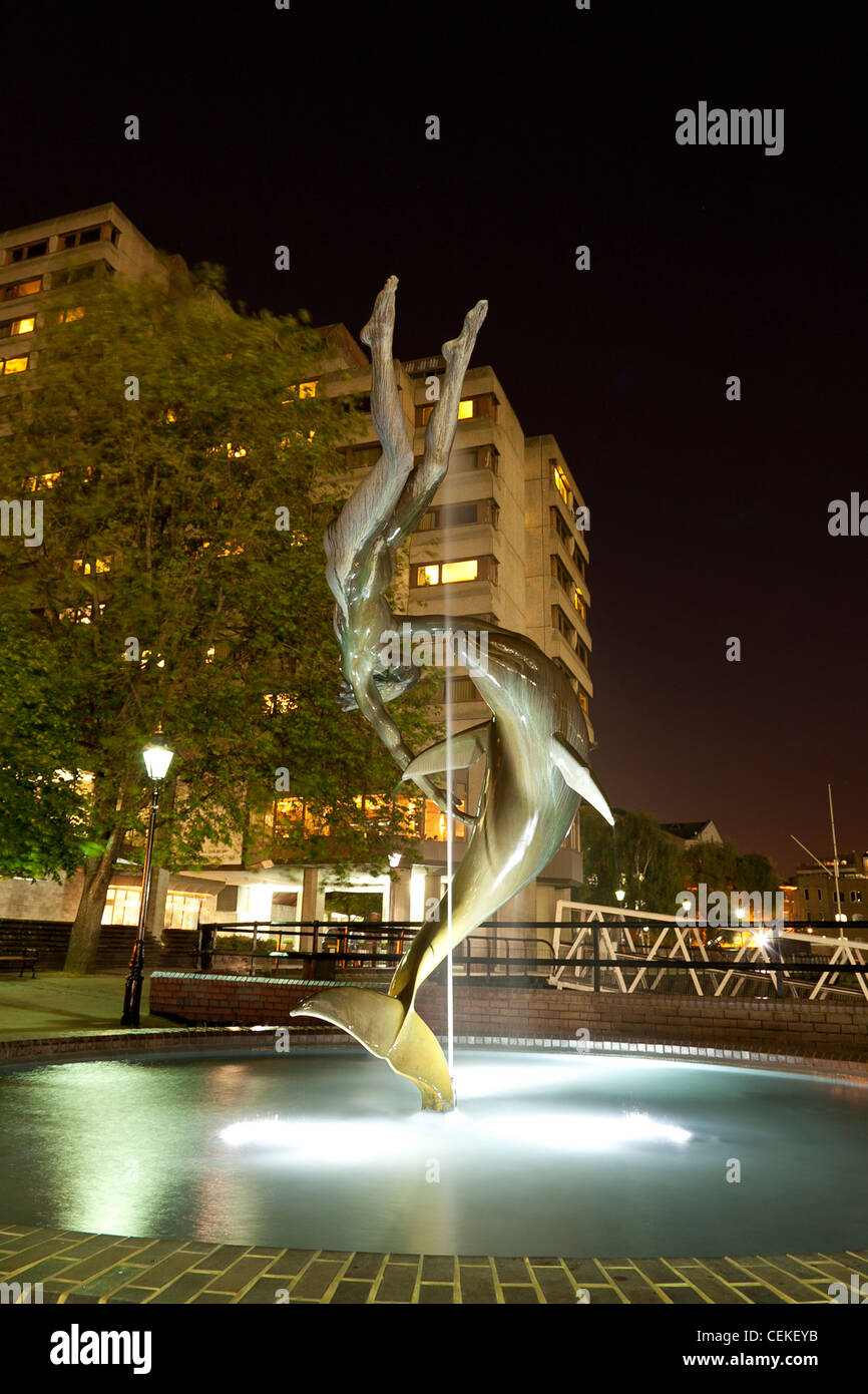 statue of dolphin and child in the fountain near tower bridge London, - Stock Image