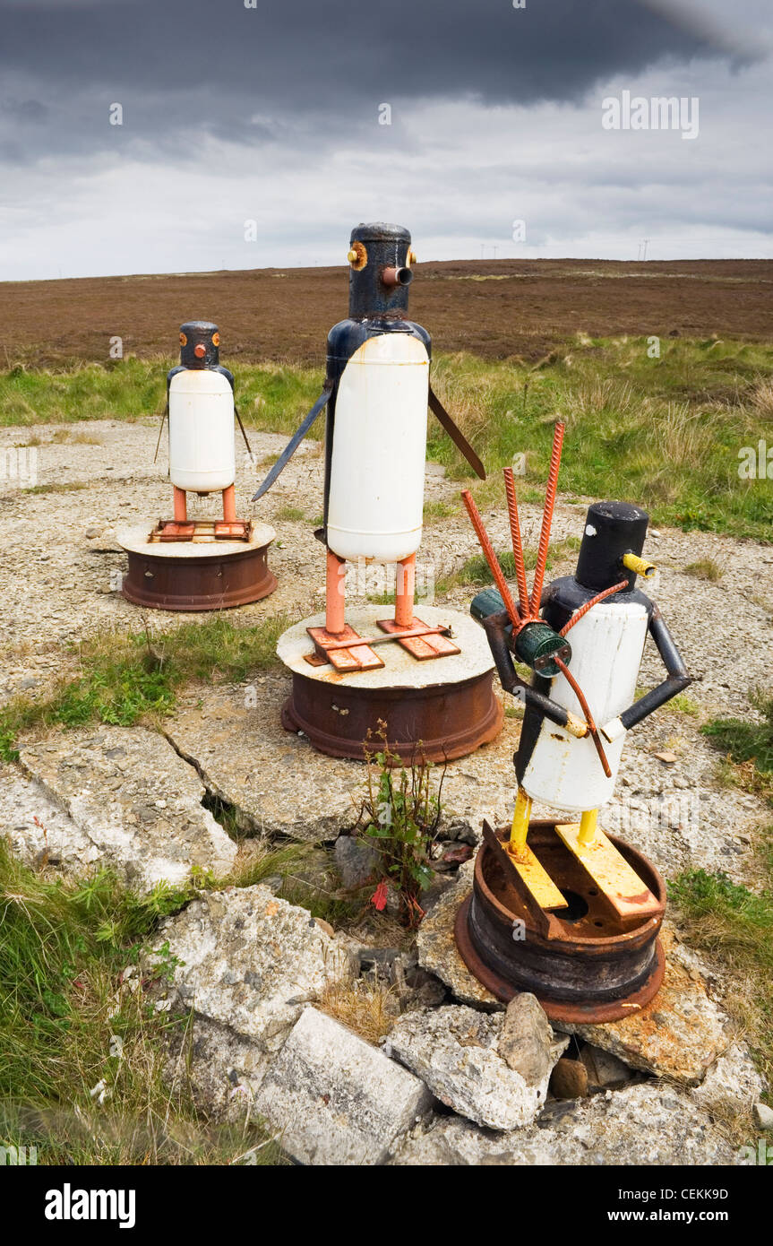 Comical sculpture of penguins on the island of Flotta, Orkney Islands, Scotland. - Stock Image