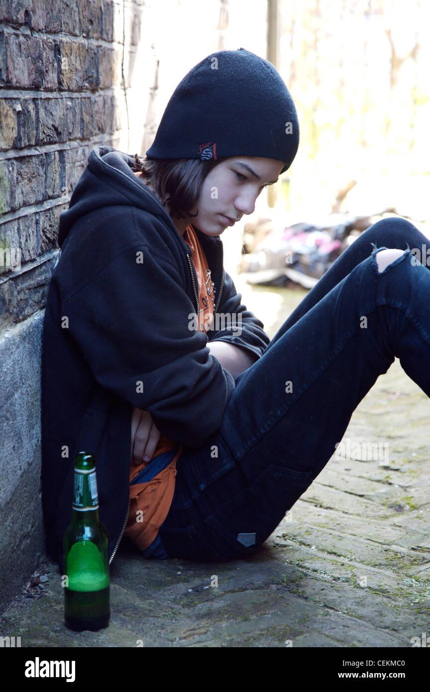 Profile of teenage boy long dark hair wearing black beanie hat Stock ... 21313b2ccd5