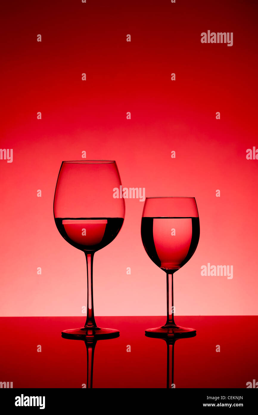 d15c97d90758 two wine glasses filled equally with liquid - Stock Image