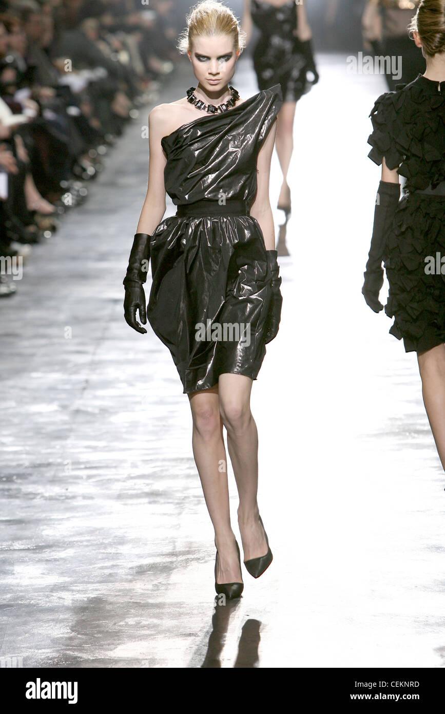 dbe2527b783 Lanvin Paris Ready to Wear Autumn Winter Female wearing a black strapless  dress a structured neckline