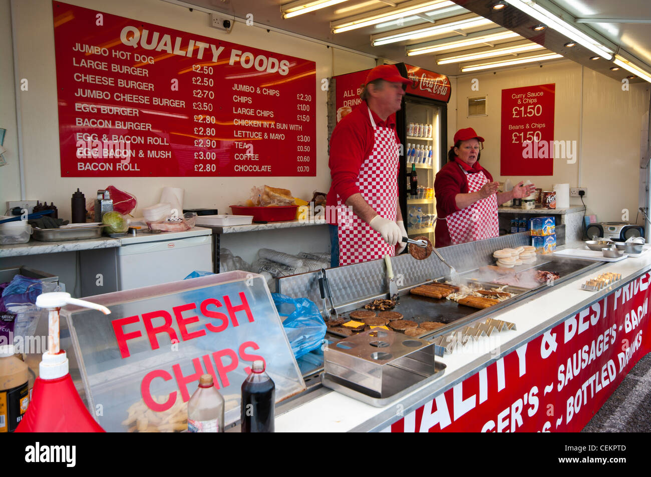 Fast Food takeaway Stall Outlet Market Retailers Refreshments Burger Hamburger Hot Dog Dogs Stalls - Stock Image