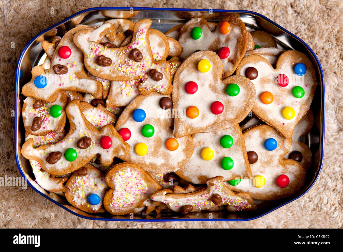 hand made colourful cookies - heart-shaped etc, in metal box - Stock Image