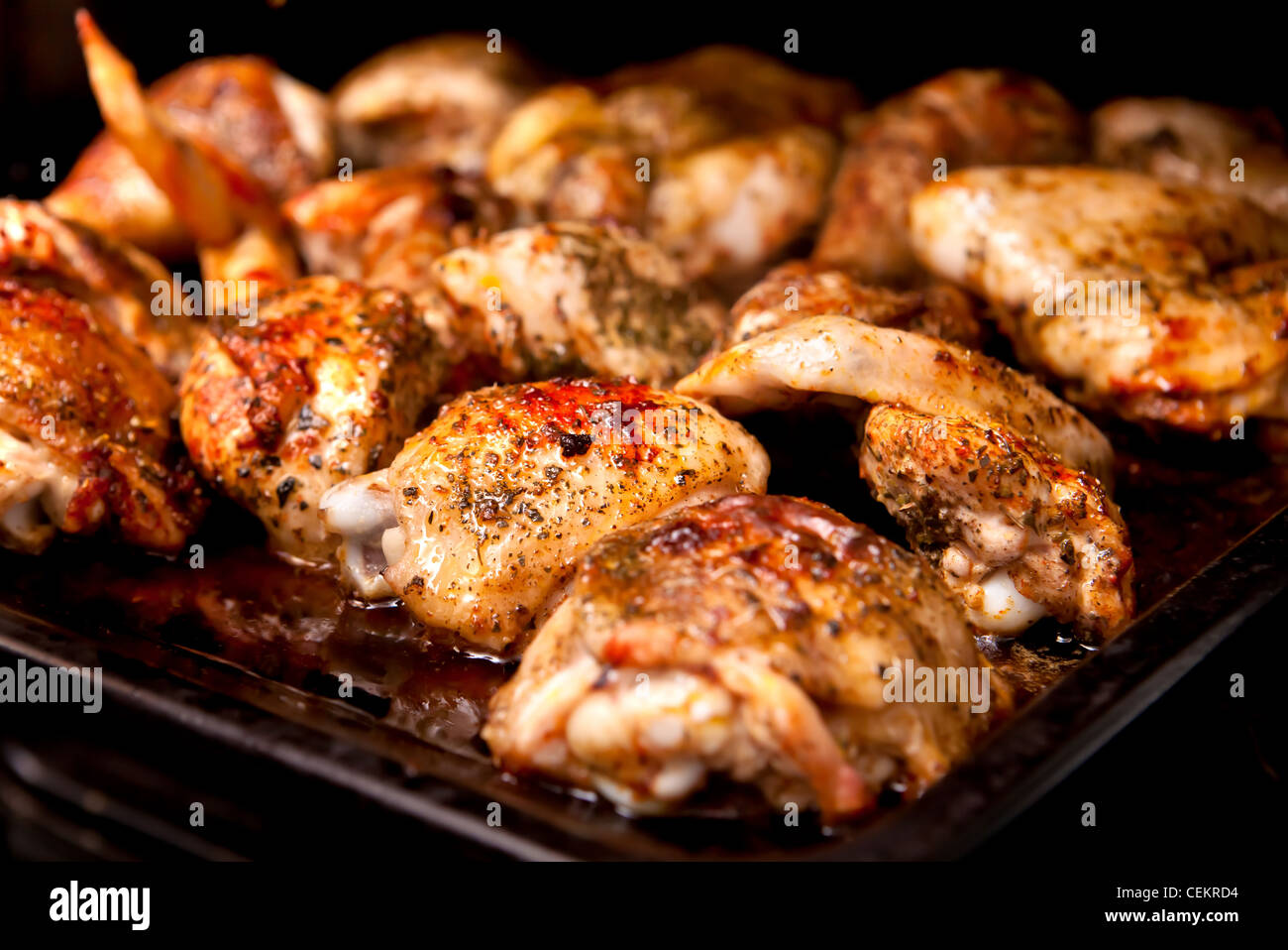 roasted chicken parts, yet in the backing oven. cooking Stock Photo ... for Cooked Chicken Parts  300lyp