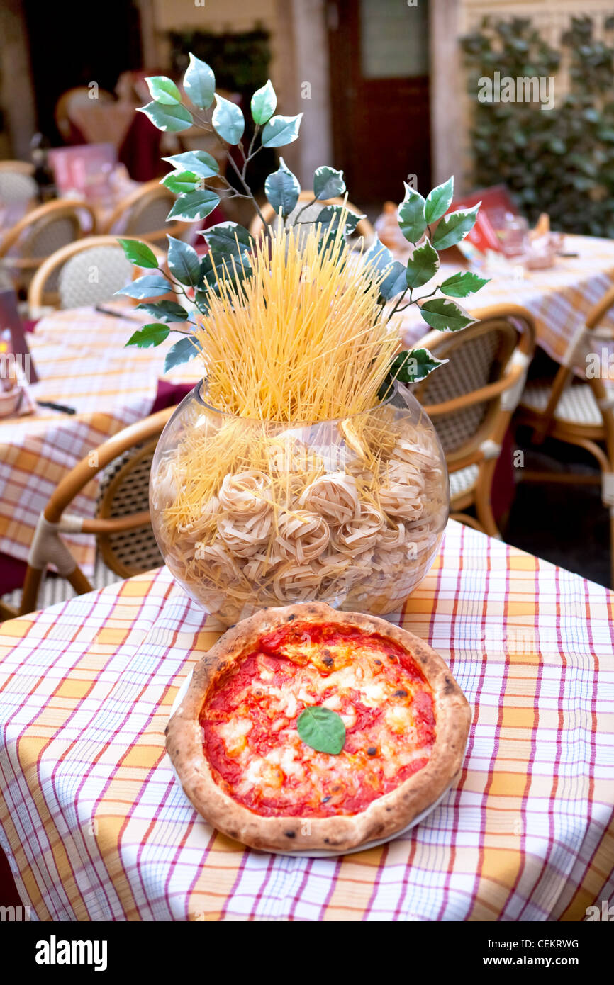 exposition of an italian restaurant - pizza and pasta - tables on the street, Rome, Italy - Stock Image