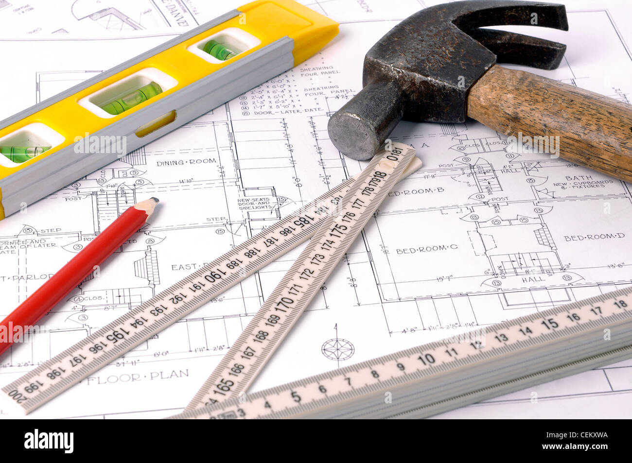 House blueprints, old hammer, pencil, level and measure - Stock Image
