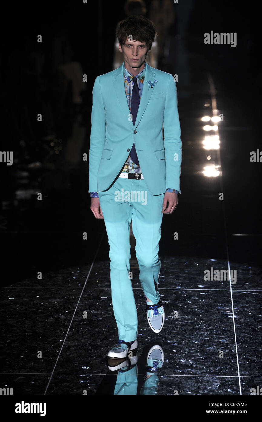 b6a1ee38c598 Gucci Milan Ready to Wear Spring Summer Model wearing light blue narrow  legged trousers, light blue jacket, navy tie, blue silk
