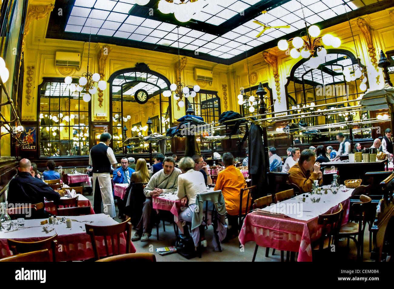 paris france people sharing meals inside chartier budget french