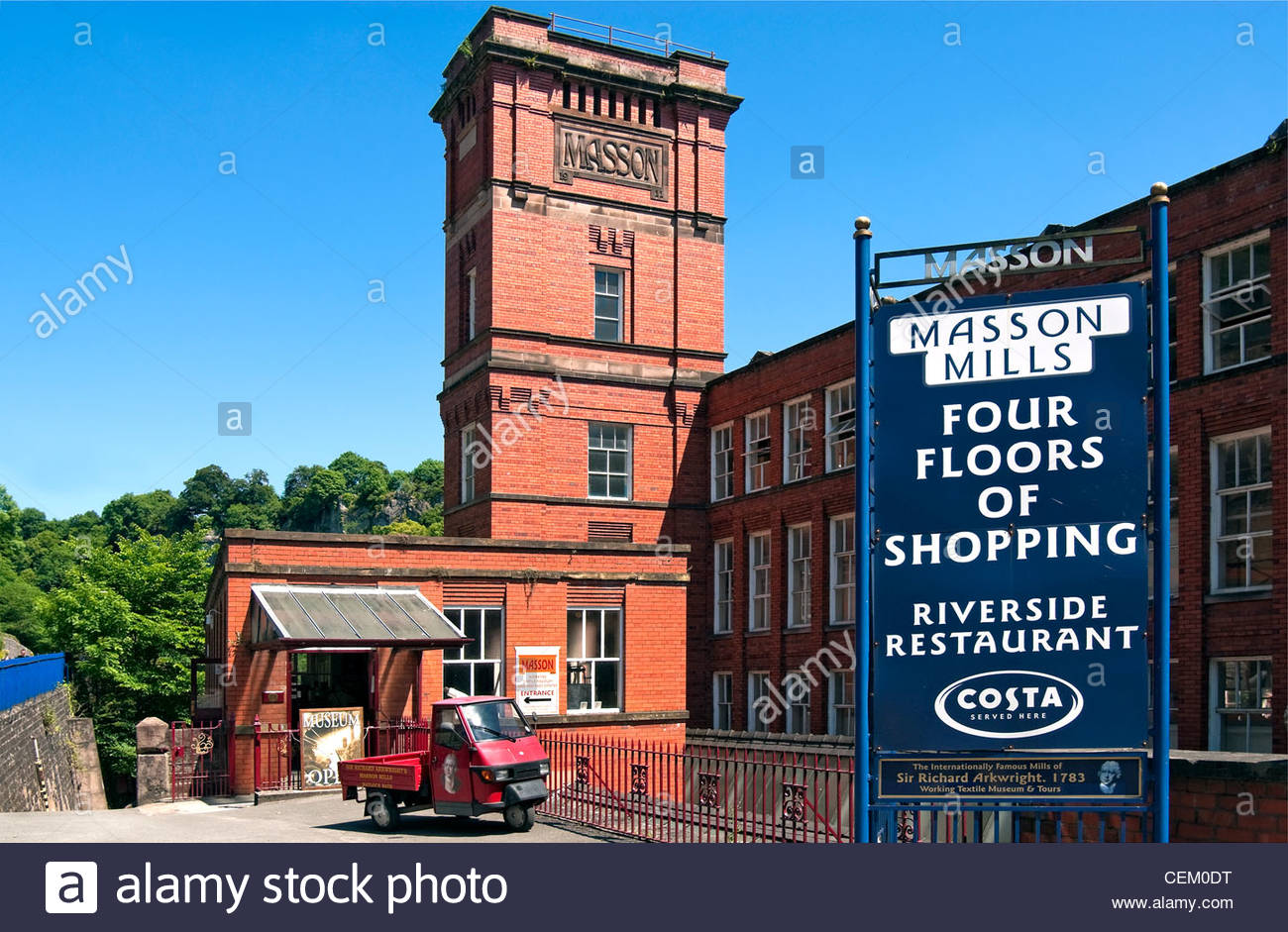 Masson Mill is a water-powered cotton spinning mill situated on the west bank of the River Derwent Valley, England. - Stock Image