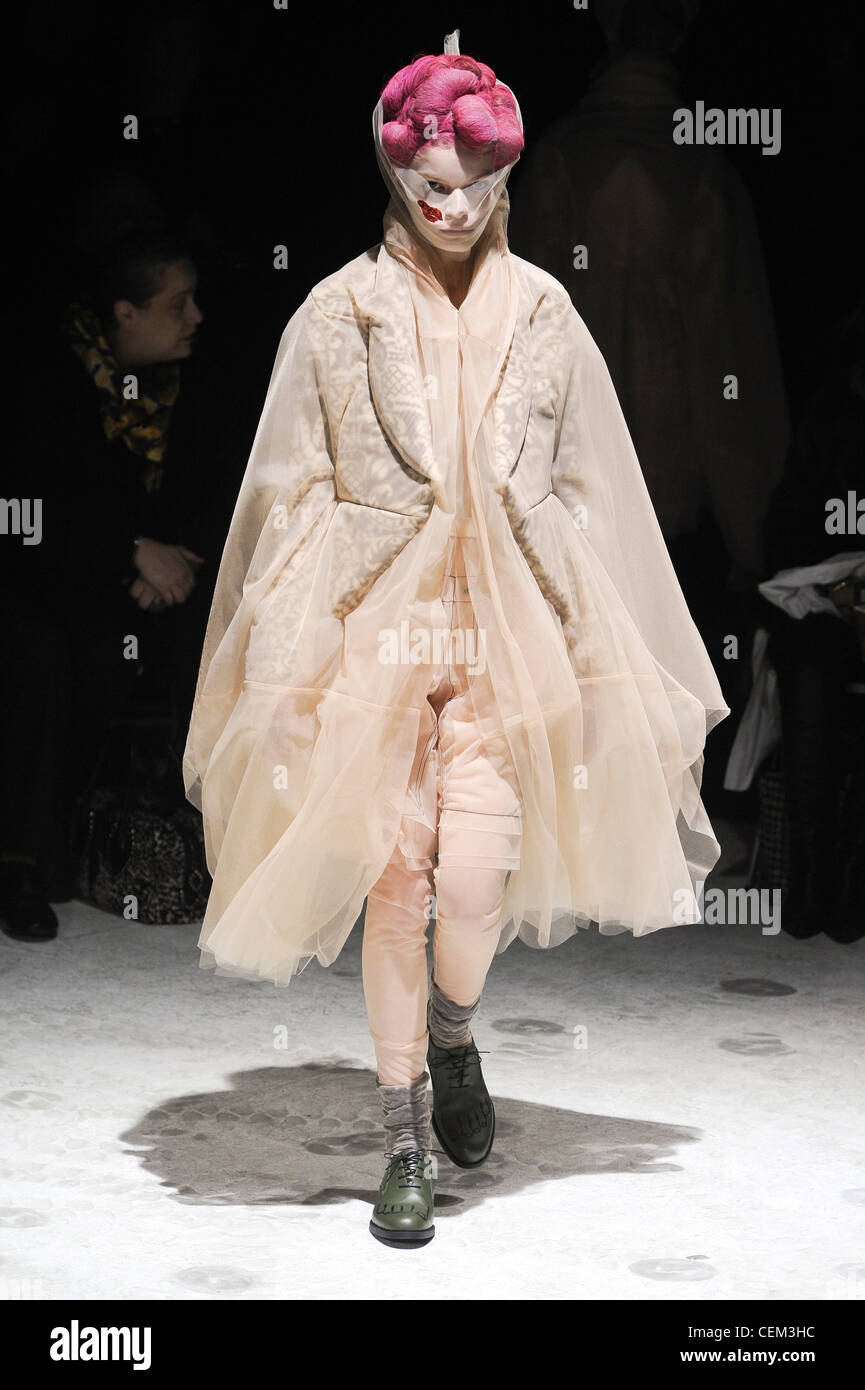 Comme des Garcons Paris Ready to Wear Autumn Winter Knee length flesh coloured multi layered tulle coat, matching - Stock Image