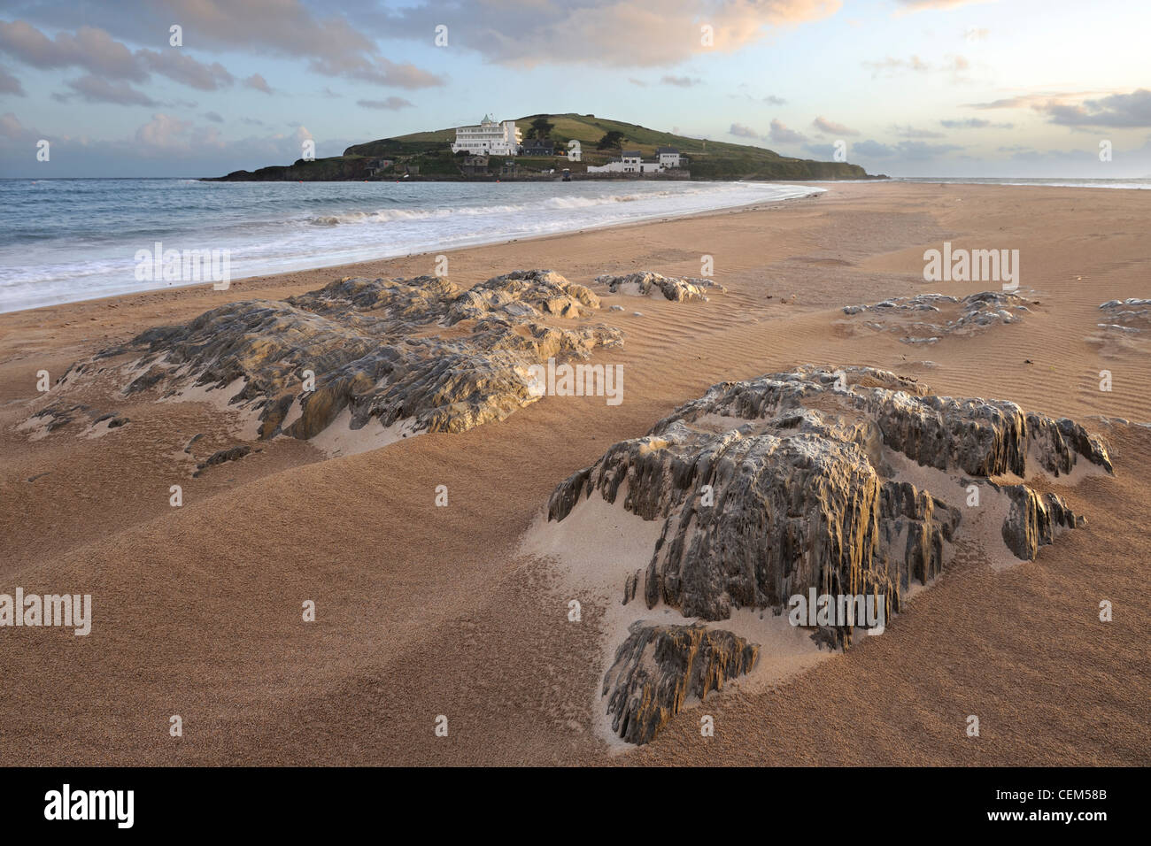 Smooth sand and rainsoaked rocks on the causeway leading to Burgh Island in the South Hams, Devon, UK. - Stock Image
