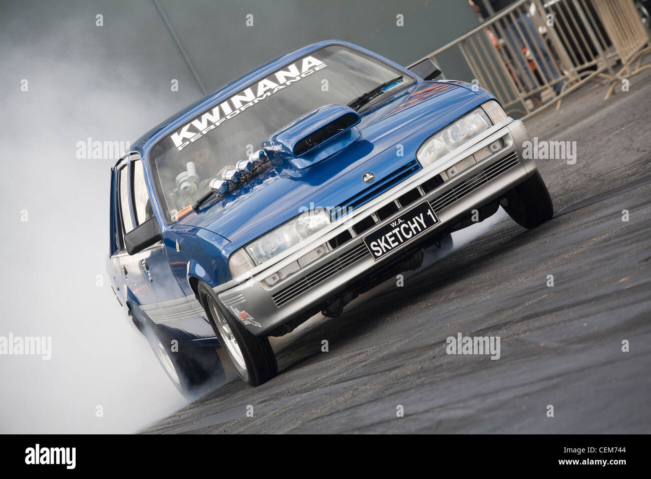 Car Spinning Wheels Stock Photos Images Wiring Up A Street Race Australian Holden Commodore Drag Racing Performing Burnout To Heat The Rear Tires