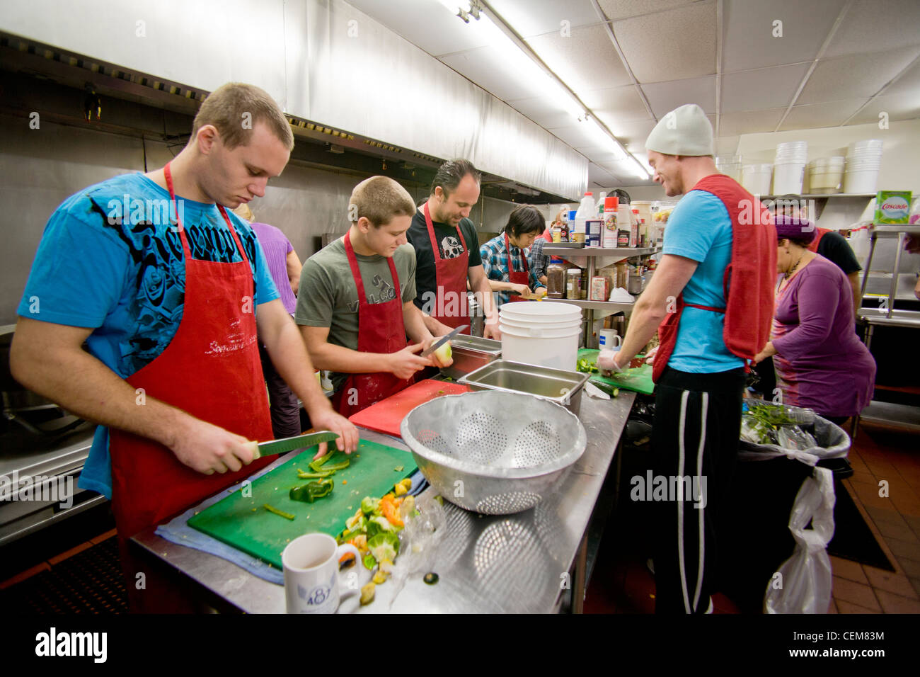 Middle Class Charitable Volunteers Pitch In At A Costa Mesa, CA, Soup  Kitchen To Feed The Homeless.