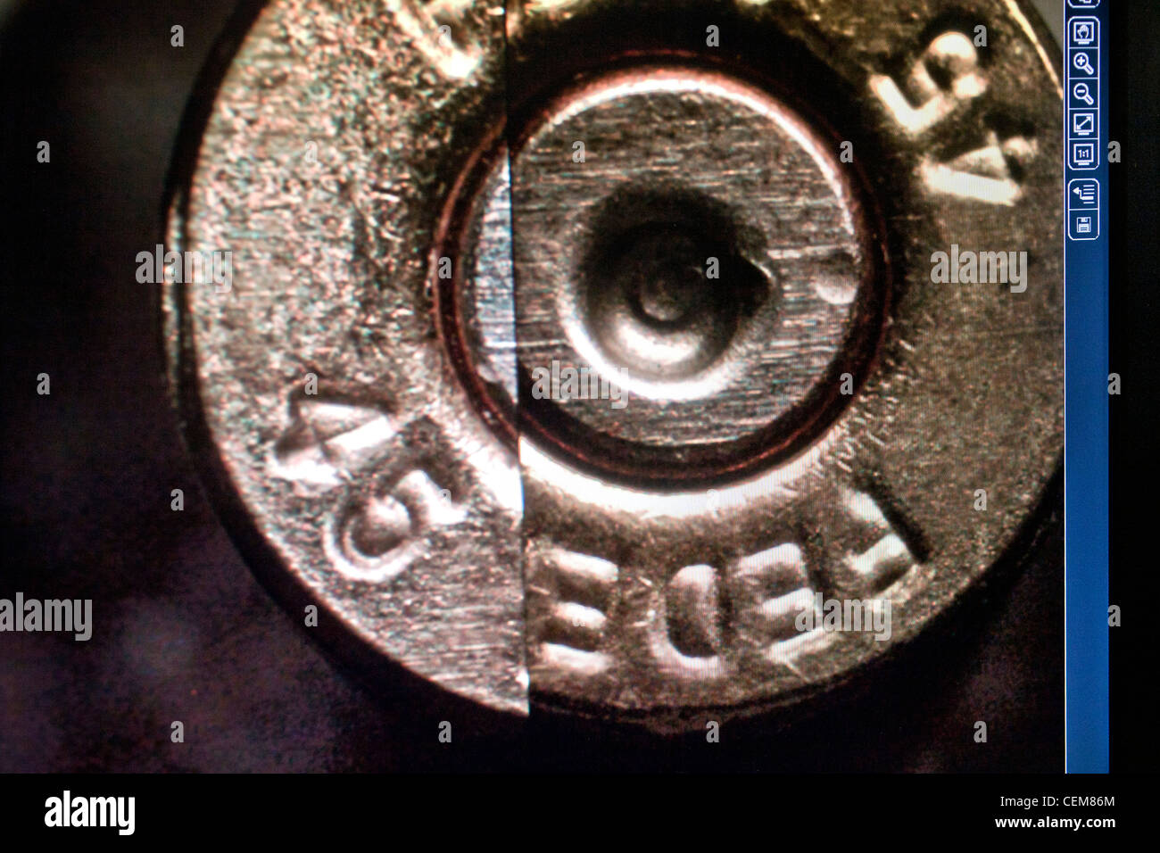 Identification details from two cartridge cases from a crime scene are juxtaposed on a comparison microscope monitor. - Stock Image