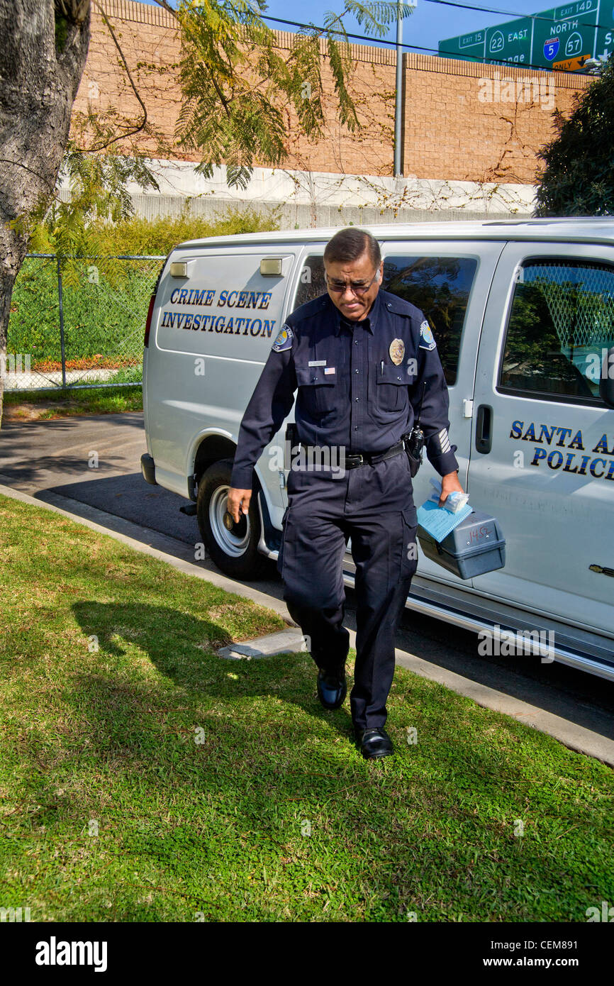 Carrying His Forensic Equipment A Pakistani American Police Crime Stock Photo Alamy