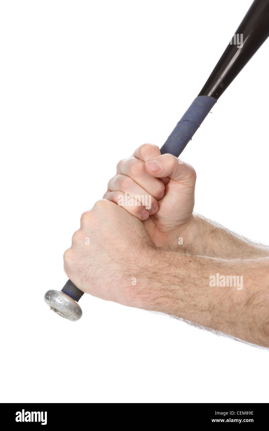 Grippng the handle of a metal baseball bat - Stock Image