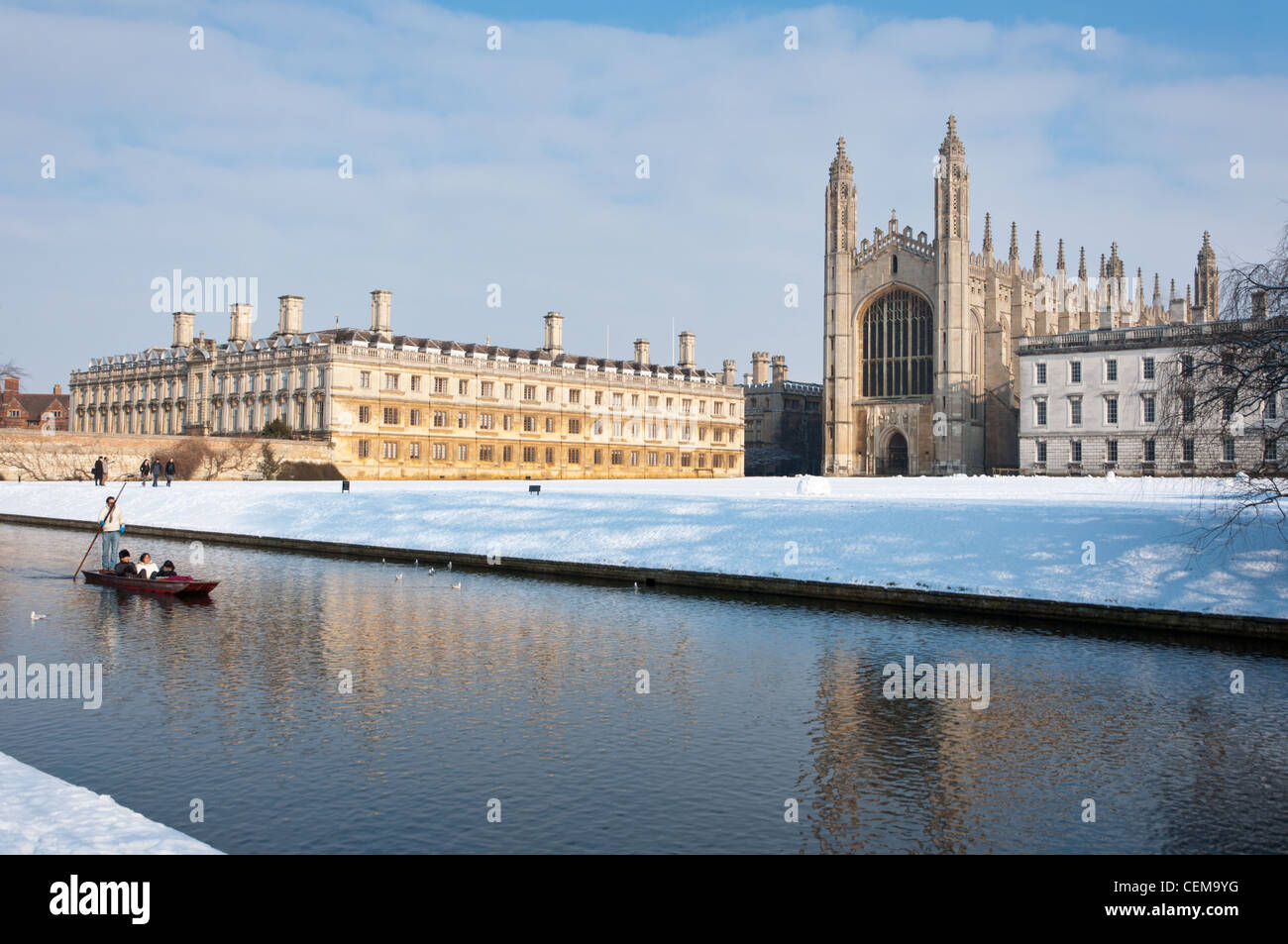 Punting along river Cam in winter snow with Kings College Chapel to the rear. Cambridge, England. Stock Photo